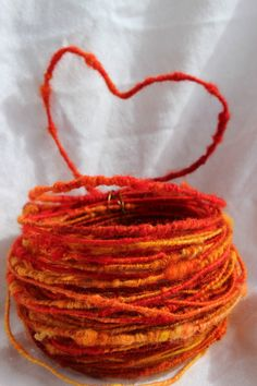 Handspun Coil Wire Core Art Yarn Fire Wire by ForestRoomArtYarns. My brain is boggled, the core is wire?  Awesome