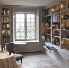Cool library idea with window seat and pull out shelves----  I wonder if this would be a hard do-it-your self?