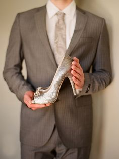Prince Charming holding her slipper...