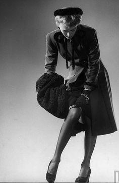 A moment of garter readjustment loveliness. #1940s