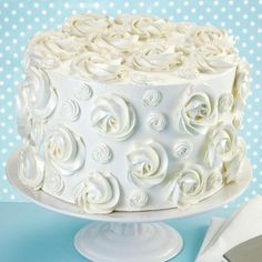 Look at the texture this rosette cake brings to the table! We've given these swirling flowers extra shimmer by finishing the cake with pearl Color Mist food color spray.