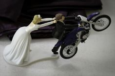 Buy this cake topper then add toy dirt bike!