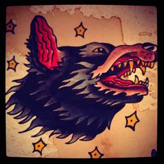 Cool little wolf head I'd love to tattoo.