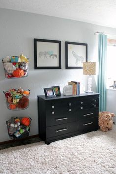 I love the baskets on the wall. Great for the boys' playroom!
