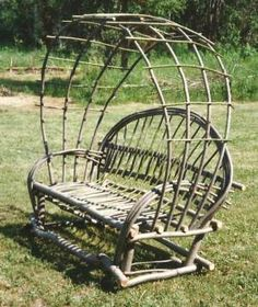 Twig Arbor Seat made from long whippy willow branches; this one took a lot of them, but imagine it with roses or honeysuckle growing on it - blissful!