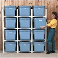 Inexpensive PVC pipe bin holder.  This way you don't have to remove the bins on top to get to the bins on the bottom.