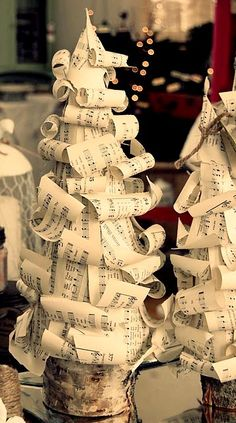 music tree - cut strips from old or photocopied sheet music, roll on make pencil to create shape; make a cone from heavy paper or use styrofoam; starting at base of cone, glue layers of rolled paper strips; hot glue to small tree slice...pretty in a group of three...