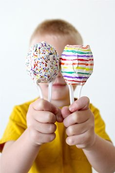 Easter Egg Maracas by danamadeit: Made with plastic Easter eggs, plastic spoons, tape, markers and popcorn kernels.