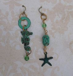 August asymmetrical earrings challenge with seahorse and barrel bead from B'Sue boutiques.