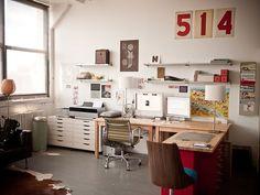 Dreamy industrial feel. L-shape with desks in corner opposite window. No curtains on window.
