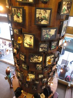 This pillar in our Makati City, Philippines store is covered in photos celebrating our baristas and their customers. starbuck