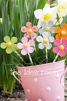 Are these cute and simple?  DIY Spring Paper Flowers at The Idea Room.