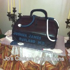 Dr Bag cake.  White cake with buttercream. Covered in chocolate fondant.  All are made with colored/ white fondant. ;0)