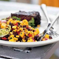 Roasted Corn, Black Bean, and Mango Salad    Go south of the border with this low-cal Mexican dish. Though it contains plenty of filing protein and fiber, serve it in a whole-wheat wrap with a bit of Monterey Jack cheese for a complete meal.    Ingredients: Vegetable oil, garlic, corn, mango, red onions, red bell pepper, limes, cilantro, salt, cumin, chipotle chile, black beans, salad greens