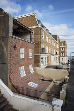 The facade of this house in the English seaside town of Margate appears to slump down into the front yard
