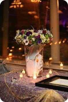 """flowers """"lid"""" on glass vase"""