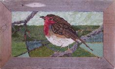 Lovely little robin hooked rug in a rustic frame.
