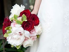 Beautiful soft bouquet with bright red roses. Seasonal Celebrations.