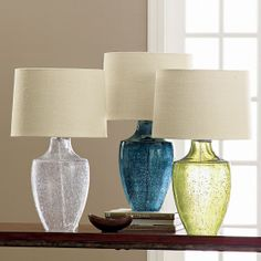 Optique Table Lamp reminds us of sea glass in the sand!