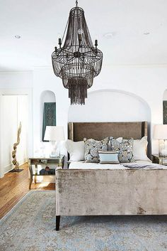 raw wood by the style files (chandelier black bedroom airy space unique lighting patterned bed)