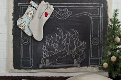 chalkboard fireplace + stockings!