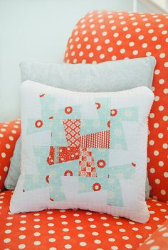 """Wild Thing"" quilt pillow -- pattern by Camille Roskelley  {love the whimsical pinwheel / windmill look}"