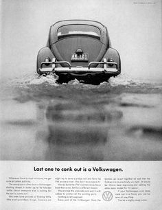 """1961 Volkswagen Beetle original vintage advertisement. Photographed in black & white negotiating a huge puddle. """"Last one to conk out is a Volkswagen."""""""