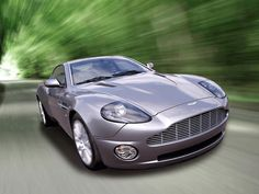Aston Martin Vanquish     Only possible if I win the lottery or find me a sugar daddy!