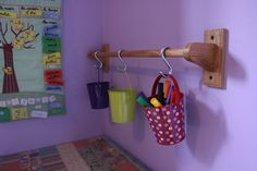 Super cute for art storage.  Here's great idea for using pails and a curtain rod or towel rack to hang small or large storage pails on your kids walls. Depending on your needs you could install a large rod and pails along a playroom wall or position a small towel rack and small pails over your kids desk for keeping homework supplies handy. Use 'S' hooks to hang the pails.