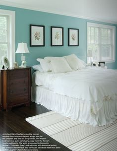 white bedding and blue walls