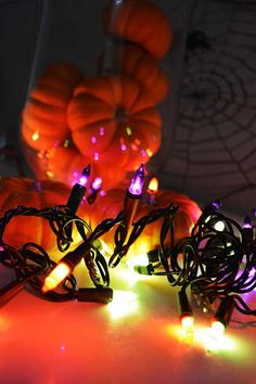 Purple, orange and green mini bulbs on black wire are the perfect #string lights for #Halloween #centerpieces, table displays and decor halloween light, string lights, mini bulb