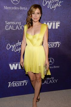 Sophia Bush displaying her cleavage in a tight and low cut yellow dress at WIF