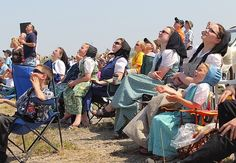 Image detail for -Members of Sprucewood Hutterite Colony look towards the sky while ...
