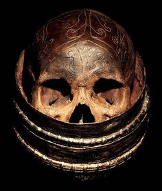 DAYAK CARVED: HEAD HUNTING HUMAN TROPHY #10  HAND CARVED SKULL  IN A BASKET  HAND CARVED HUMAN BONE  THE DAYAK TRIBE, FROM BORNEO ISLAND  INDONESIA, CARVE DESIGNS INTO THE SKULLS  OF THEIR HEADHUNTED VICTIMS AND INSERT WOODEN FIGURES.