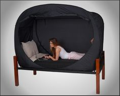 Privacy Pop bed tent. What a great idea for dorms and beyond. I bet my boys would love this.