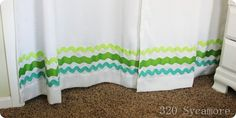 Dress up simple curtains with ric rac + fabric glue