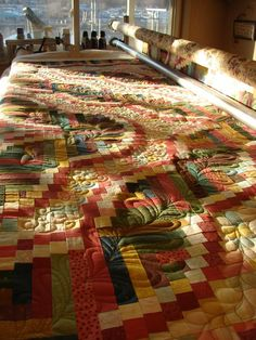 Snake River Log Cabin beautiful piecing and quilting.