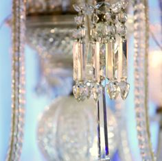Vintage crystal chandeliers quietly sparkle above celebrations at The Ritz-Carlton, Atlanta.