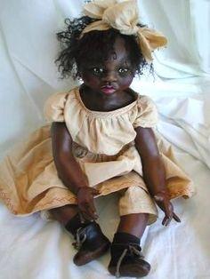 Clay over cloth doll.  Doll artist: Teresa Baker.