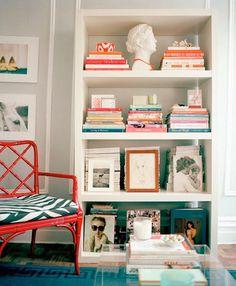 love the bookshelf arrangement + colors