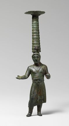 Shaft of a bronze thymiaterion (incense burner), Etruscan, 5th century B.C. During the fifth century B.C., the Etruscans were expanding their trade contacts throughout the Mediterranean world. The man in Persian costume is an unusual expression of the Etruscan interest in the exotic.