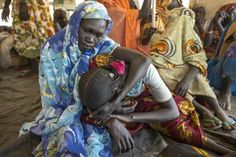 Nyudi, 54, grieves in South Sudan at the wake for her son, Jadin. He survived the fighting in their home village in #Sudan that forced them to flee, only to die in a refugee camp in South Sudan from a stomach ailment. © UNHCR/S.Rich