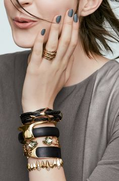 Stacked bangles in black & gold