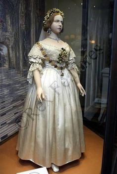 """Queen Victoria's Feb 10 1840 wedding dress. ~ On her wedding day (10 February 1840) Queen Victoria wore a gown of white satin, trimmed with white lace matching her veil, and a crown of orange blossoms. Hers was the first """"white wedding."""""""