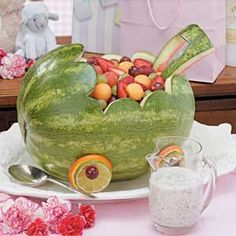 fruit salad in a baby carriage. perfect for a baby shower!