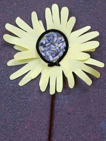 How to Make It: Trace child's hand 8 to 10 times on yellow construction paper, using pencil. Have child cut out the hand shapes (littler kids will need help). Arrange the hands upside down (so the pencil marks don't show), overlapping in a circle, and glue, tape or staple together. Staple straight brown pipe cleaner to back of sunflower. Cut black pipe cleaner in half and bend into circle. Staple to center of flower. Use glue to add sunflower seeds to center.