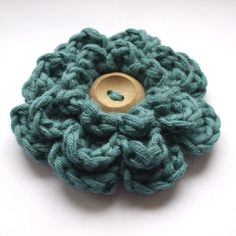 teal frothy flower