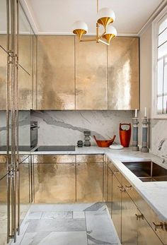 Gilded Kitchen Cabinetry with Brass Chandelier Jean-Louis Denoit