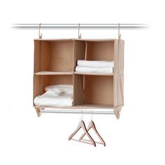 Hanging cubbies make great use of small spaces and keep sweaters neatly folded. #OrganizeDotCom #dreamdorm