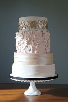 10 Extraordinary Wedding Cake Designs. - - 10. Blush and Champagne Wedding Cake  Do you tend to gravitate towards soft pastel hues? Take a cue from this cake and ask your baker to construct completely different designs for each tier. This creates a romantic look without playing it too safe.